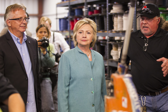 Democratic presidential nominee Hillary Clinton tours Mojave Electric with Donald Campbell, left, executive director for the Southern Nevada Chapter of the National Electrical Contractors Associat ...