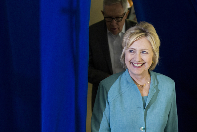 Democratic presidential nominee Hillary Clinton makes her way to the stage for a campaign rally at the International Brotherhood of Electrical Workers headquarters on Thursday, Aug. 4, 2016, in La ...