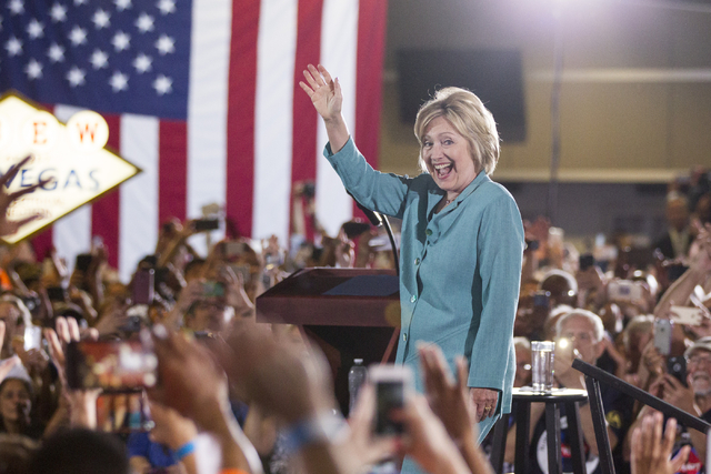 Democratic presidential nominee Hillary Clinton takes the stage at a campaign rally at the International Brotherhood of Electrical Workers headquarters on Thursday, Aug. 4, 2016, in Las Vegas. Eri ...