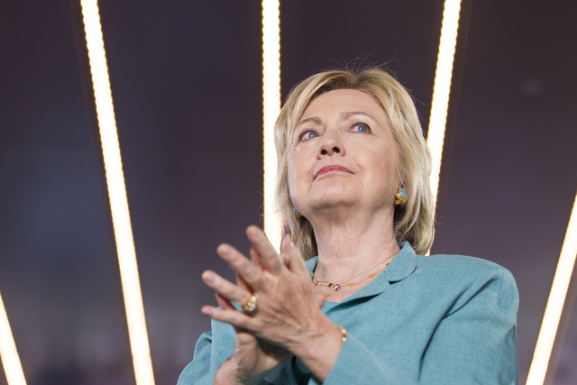 Democratic presidential nominee Hillary Clinton sits on stage before her introduction during a campaign rally at the International Brotherhood of Electrical Workers headquarters on Thursday, Aug.  ...