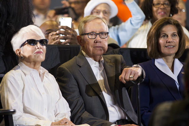 Landra Gould, from left, with her husband U.S. Sen. Harry Reid, and U.S. Senate Democratic candidate Catherine Cortez Masto, listen to Hillary Clinton at a rally  Aug. 4, 2016, in Las Vegas. (Erik ...