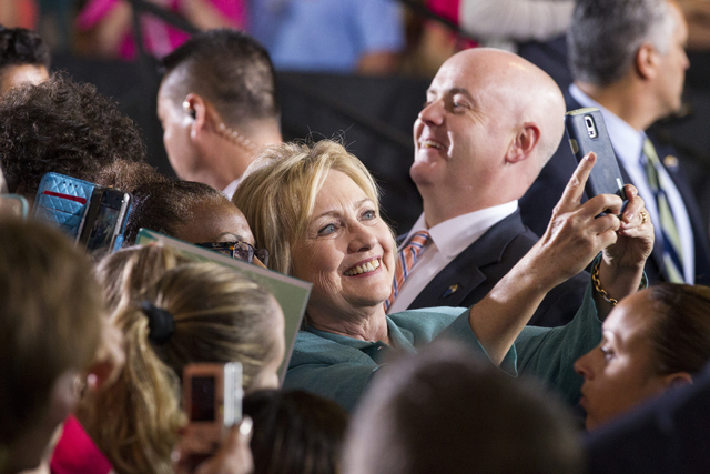 Democratic presidential candidate Hillary Clinton takes photos with supporters following her speech at a campaign rally at the International Brotherhood of Electrical Workers headquarters on Thurs ...