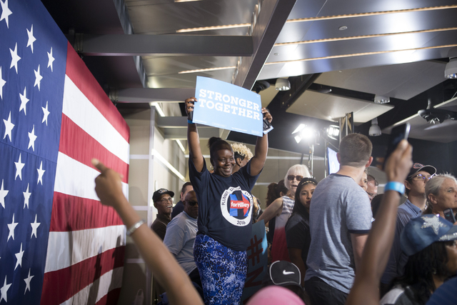 Supporters get ready to see Democratic presidential candidate Hillary Clinton during a campaign rally at the International Brotherhood of Electrical Workers headquarters on Thursday, Aug. 4, 2016, ...