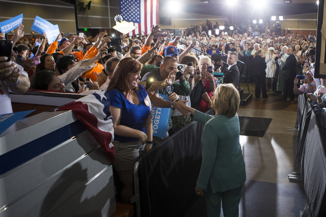 Democratic presidential candidate Hillary Clinton walks to the stage for a campaign rally at the International Brotherhood of Electrical Workers headquarters on Thursday, Aug. 4, 2016, in Las Vega ...