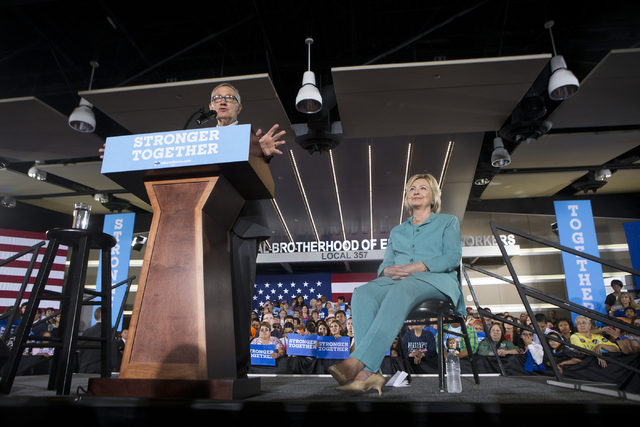 U.S. Sen. Harry Reid introduces Democratic presidential candidate Hillary Clinton during a campaign rally at the International Brotherhood of Electrical Workers headquarters on Thursday, Aug. 4, 2 ...