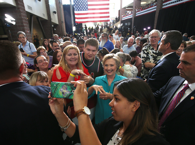 Western Nevada College Deaf Studies Professor Cindy Frank teaches Democratic presidential candidate Hillary Clinton some sign language during a campaign stop in Reno, Nev., Thursday, Aug. 25, 2016 ...