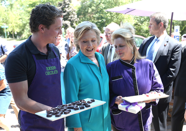Dorindaճ Chocolateճ workers offer candy to Democratic presidential candidate Hillary Clinton during a campaign stop in Reno, Nev., Thursday, Aug. 25, 2016. Cathleen Allison/Las Vegas R ...