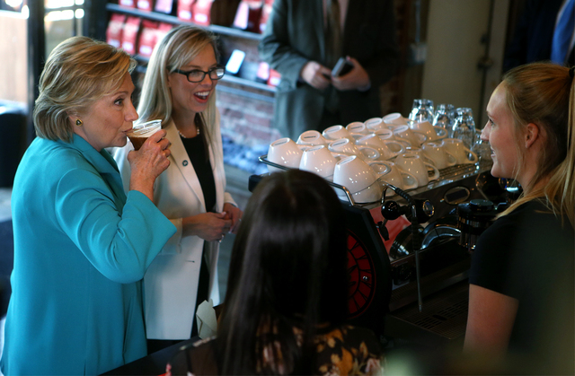 Democratic presidential candidate Hillary Clinton, left and Reno Mayor Hillary Schieve talk with Hub coffee shop workers during a campaign stop in Reno, Nev., Thursday, Aug. 25, 2016. Cathleen All ...