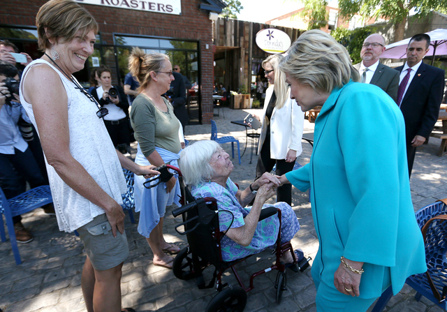 Democratic presidential nominee Hillary Clinton talks with Jennifer Snyder, 85, and her daughter Lisa during a campaign stop in Reno, Nev., on Thursday, Aug. 25, 2016. Cathleen Allison/Las Vegas R ...