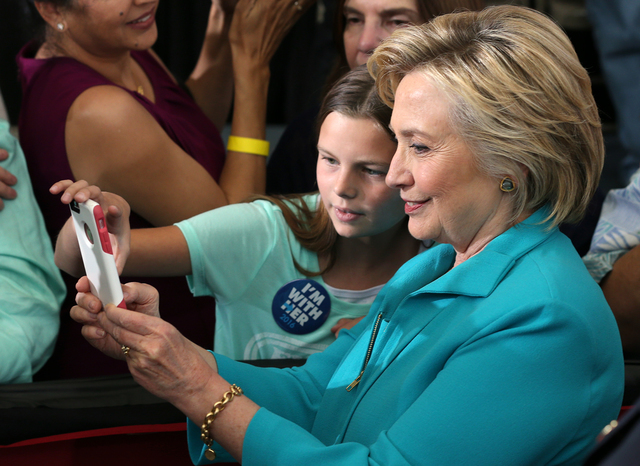 Democratic presidential nominee Hillary Clinton takes a selfie with supporter Jessica Rivera, 10, during a campaign stop at Truckee Meadows Community College in Reno, Nev., on Thursday, Aug. 25, 2 ...