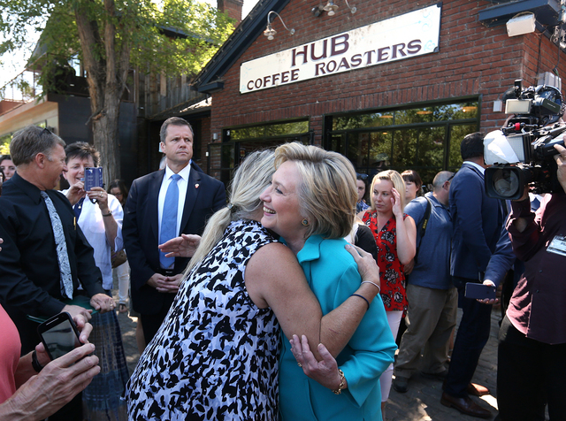 Democratic presidential nominee Hillary Clinton gets a hug from a supporter during a campaign stop in Reno, Nev., on Thursday, Aug. 25, 2016. Cathleen Allison/Las Vegas Review-Journal