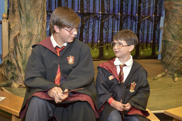 "Evan Kaz, left, and Jonathon Harte (cq) chat during a ""Countdown to Midnight Party"" for the release of ""Harry Potter and the Cursed Child Parts One and Two"" special rehearsal edition scrip ..."