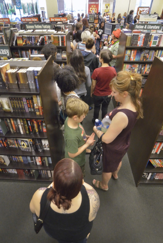 "People line up to sign in and get wristbands during a ""Countdown to Midnight Party"" for the release of ""Harry Potter and the Cursed Child Parts One and Two"" special rehearsal edition scrip ..."
