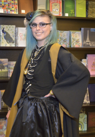"Bookseller Kaira Flowers is shown during a ""Countdown to Midnight Party"" for the release of ""Harry Potter and the Cursed Child Parts One and Two"" special rehearsal edition script at Barnes ..."