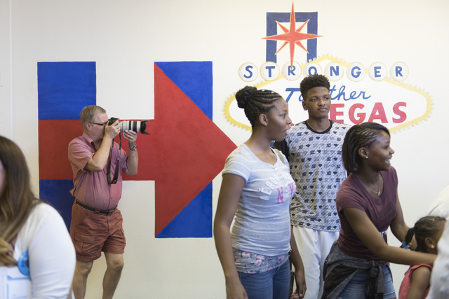 Supporters gather during the opening of Democratic presidential candidate Hillary Clinton's new campaign office in North Las Vegas, Sunday, Aug. 28, 2016. Jason Ogulnik/Las Vegas Review-Journal