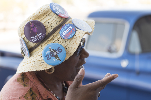 Hillary Clinton supporter Katie Jones wears a hat featuring various political pins during the opening of Democratic presidential candidate Hillary Clinton's new campaign office in North Las Vegas, ...