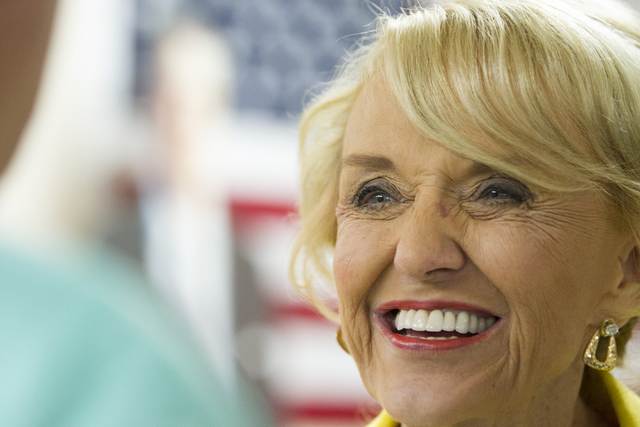 Former Arizona Gov. Jan Brewer attends the grand opening for the new campaign office for Republican presidential candidate Donald Trump in Las Vegas on Saturday, Aug. 27, 2016, in Las Vegas. (Erik ...