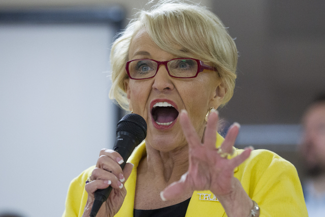 Former Arizona Gov. Jan Brewer speaks during the grand opening for the new campaign office for Republican presidential candidate Donald Trump in Las Vegas on Saturday, Aug. 27, 2016, in Las Vegas. ...