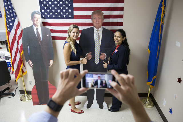 Mindy Gannon, left, and Myrian Witcher take a photo together during the grand opening for the new campaign office for Republican presidential candidate Donald Trump in Las Vegas on Saturday, Aug.  ...