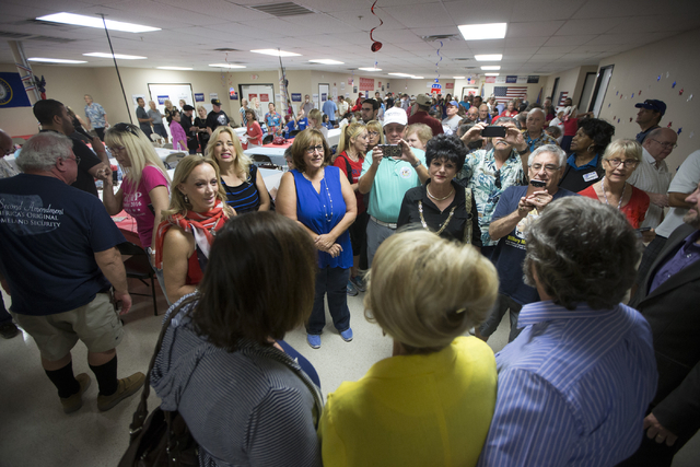 Former Arizona Gov. Jan Brewer takes photos with supporters during the grand opening for the new campaign office for Republican presidential candidate Donald Trump in Las Vegas on Saturday, Aug. 2 ...