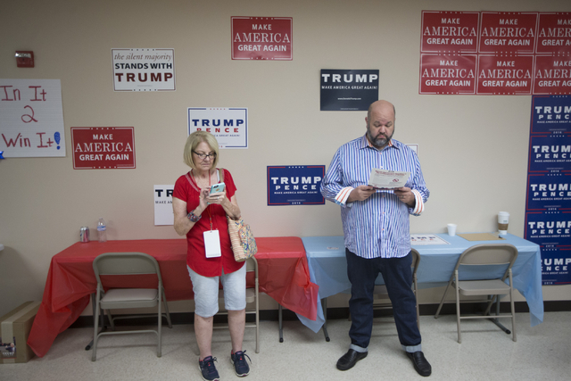 Sunnie Dotson, left, and Robert Barnes attend the grand opening for the new campaign office for Republican presidential candidate Donald Trump in Las Vegas on Saturday, Aug. 27, 2016, in Las Vegas ...