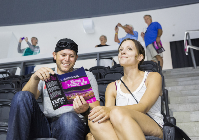 Austin Johnson, left, and Sarah Concanon scout out their seats at T-Mobile Arena during an open house for Las Vegas' NHL expansion team on Monday, August 1, 2016, in Las Vegas. (Benjamin Hager/Las ...