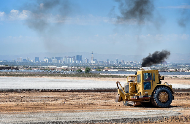 Earth moving equipment grade a parcel for a future e-commerce warehouse location Thursday, Aug. 18, 2016, in North Las Vegas. The site at the southwest corner of Ann Road and Sloan Lane is slated  ...