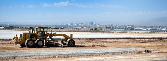 Earth moving equipment grade a parcel for a future e-commerce warehouse location Thursday, Aug. 18, 2016 in North Las Vegas. The site at the southwest corner of Ann Road and Sloan Lane is slated t ...