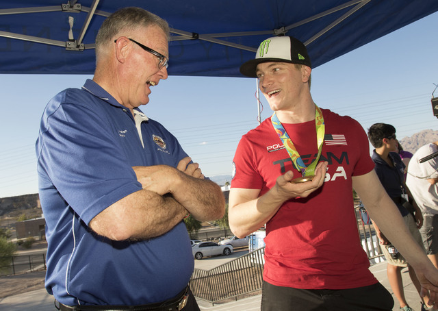 BMX Olympic gold medalist Connor Fields, right, shows his medal to Henderson Mayor Andy Haffen during a celebration at the Whitney Mesa BMX Track on Tuesday, Aug. 30, 2016, in Henderson. Connor re ...