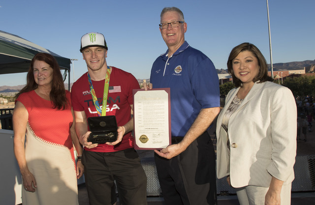 BMX Olympic gold medalist Connor Fields, second left, poses for a photo with Henderson Mayor Andy Haffen, Councilwoman Debra March, left, and Councilwoman Gerri Schroder at the Whitney Mesa BMX Tr ...