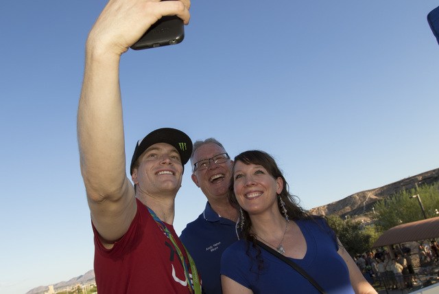 BMX Olympic gold medalist Connor Fields, left, takes a selfie with Henderson Mayor Andy Haffen, center, and his daughter Amy Haffen after a celebration at the Whitney Mesa BMX Track on Tuesday, Au ...