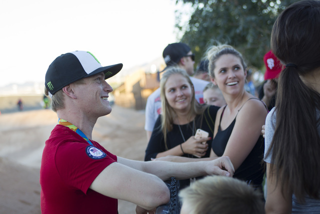 BMX Olympic gold medalist Connor Fields talks to friends and fans after a celebration at the Whitney Mesa BMX Track on Tuesday, Aug. 30, 2016, in Henderson. Connor received a key to the city and a ...
