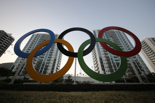 A representation of the Olympic rings are displayed in the Olympic Village in Rio de Janeiro, Brazil, Saturday, July 23, 2016. The brand new complex of residential towers are where nearly 11,000 a ...