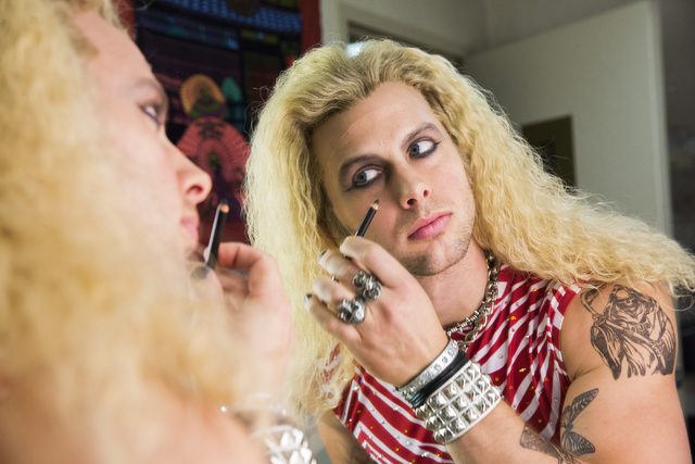 "Brett Stoelker slaps on the ""guy-liner"" to become obnoxious '80s rock god ""Stacee Jaxx"" in ""Rock of Ages"" at the Rio. ""It's not your typical show, he says. (Benjamin Hager/Las Vegas Review-Jou ..."