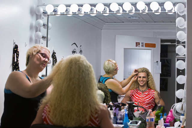 "Meredith Walker, left, applies Brett Stoelker's wig in preparation to play rock star ""Stacee Jaxx"" before the start of ""Rock of Ages"" at the Rio on Tuesday, June 28, 2016, in Las Vegas. ""The music ..."
