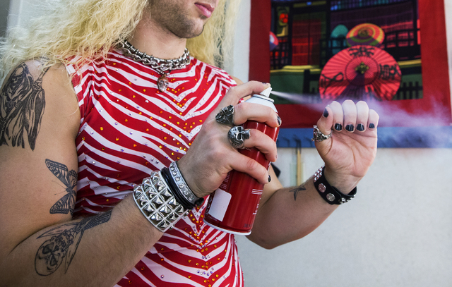 "Brett Stoelker, who plays rock star ""Stacee Jaxx,"" sprays his fingernail paint backstage before the start of ""Rock of Ages"" at the Rio on Tuesday, June 28, 2016, in Las Vegas. ""The music is awesom ..."