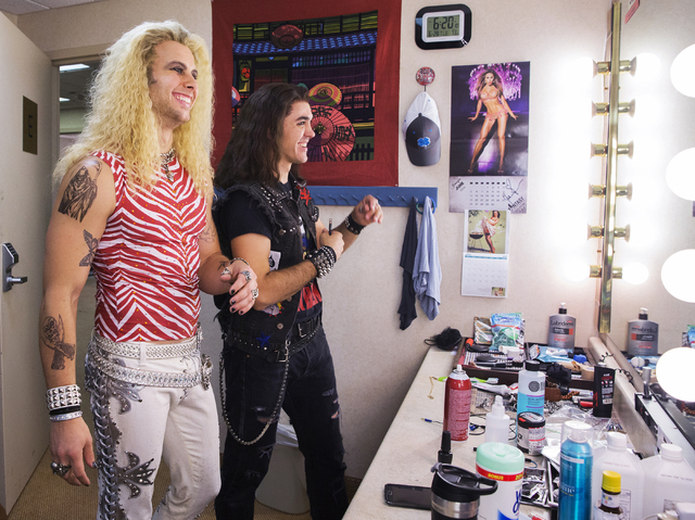 "Actors Brett Stoelker, left, rock star ""Stacee Jaxx,"" and Paul Johnson, bar-back ""Drew,"" joke around backstage before the start of ""Rock of Ages"" at the Rio on Tuesday, June 28, 2016, in Las Vegas ..."