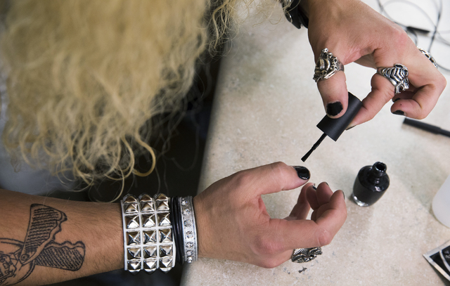 "Brett Stoelker paints his nails in preparation to play rock star ""Stacee Jaxx"" before the start of ""Rock of Ages"" at the Rio on Tuesday, June 28, 2016, in Las Vegas. ""The music is awesome,"" said S ..."