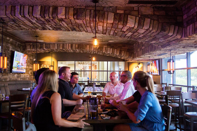 Guests dine by a large window displaying the in-house brewery at PT's Brewing Company off of Tenaya Way and Cheyenne Avenue in Las Vegas on Thursday, Aug. 4, 2016. Elizabeth Brumley/Las Vegas Re ...