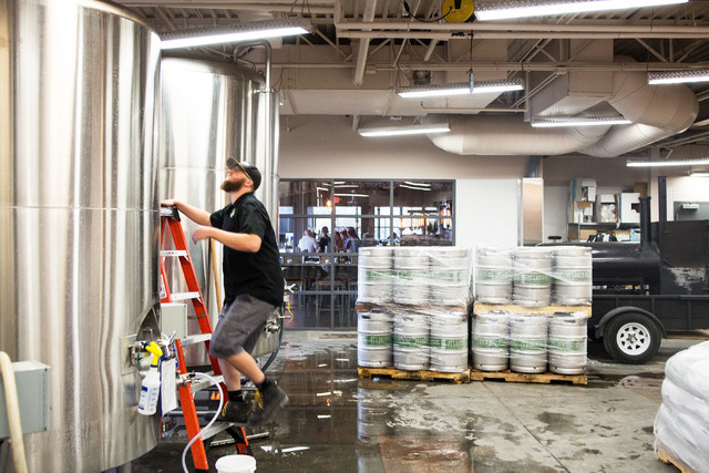 David Marcolongo checks the pressure of the carbonation of the Horizon Ale, a craft beer made in house at PT's Brewing Company off of Tenaya Way and Cheyenne Avenue in Las Vegas on Thursday, Aug ...