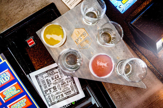 A selecton of in house craft beers are displayed on a Nevada shaped platter made in house at PT's Brewing Company off of Tenaya Way and Cheyenne Avenue in Las Vegas on Thursday, Aug. 4, 2016. El ...