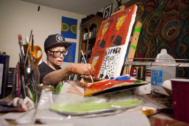 "Las Vegas artist Dave Dave works on his ""Lifted"" painting series at his Las Vegas apartment June 20. His father tried to kill him when he was 6 by setting him on fire. (Loren Townsley/View) Follow ..."
