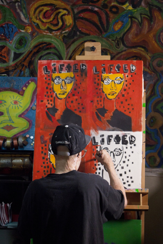 "Artist Dave Dave works on his ""Lifted"" painting series at his Las Vegas apartment June 20. (Loren Townsley/View) Follow @lorentownsley on Twitter"