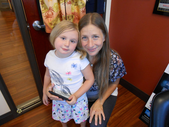 Dawn Abraw and her grandaughter, Aeva, smile at Nevada Adult Day Healthcare Centers, 8695 S. Eastern Ave., on July 21. Linda J. Simpson/Special to View