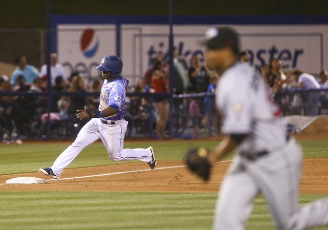 Las Vegas 51s player Dilson Herrera reaches third base during a baseball game against the El Paso Chihuahuas at Cashman Field in Las Vegas on Friday, May 13, 2016. Chase Stevens/Las Vegas Review-J ...