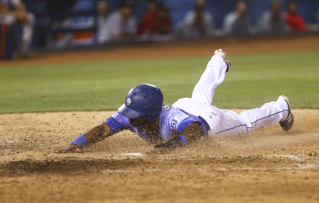Las Vegas 51s player Dilson Herrera slides in to score a run during a baseball game against the El Paso Chihuahuas at Cashman Field in Las Vegas on Friday, May 13, 2016. Chase Stevens/Las Vegas Re ...