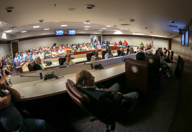 Four overflow rooms were needed as more than 700 people attend a subcommittee hearing at the Legislative Building in Carson City, Nev., on Friday, Aug. 26, 2016. Angry domestic well owners are con ...