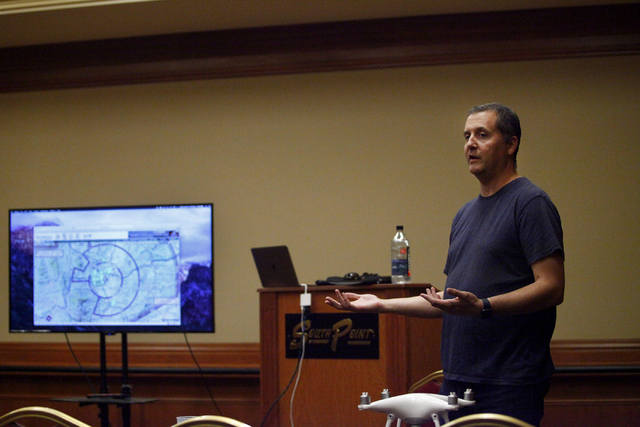 Gary Buzel, vice president of Education and Training at AviSight Aerial and Drone Services, explains how to read an aeronautical chart during a drone pilot training course at the South Point Casin ...