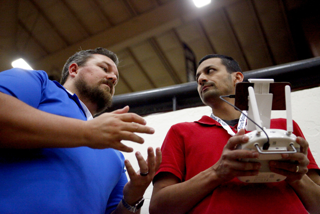 William OՄonnell, left, of AviSight Aerial and Drone Services, tutors Sam Zamarron of Irondale, Alabama during a drone pilot training course at the South Point Casino on on Thursday,  Aug. 25, 20 ...