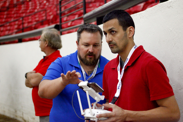 Sam Zamarron, right, of Irondale, Alabama, gets tips on drone piloting from William OՄonnell of AviSight Aerial and Drone Services during a pilot training course at the South Point Casino on Thur ...